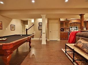 man cave or room using a light tan or gray with red accents