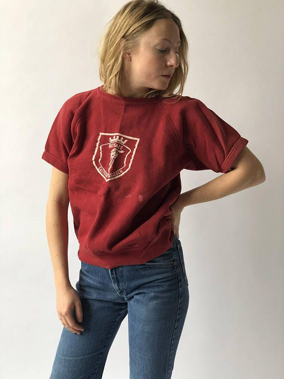 Softest Red Sweatshirt Tee with Eastern Hancock Royals School Crest on the front. Maker: No tag Material: Cotton Blend Condition: Good with some light bleach spots which we believe add character. Best fits Small/Medium. Measurements: Chest: 21 Length: 23 Model is 56 and wears small