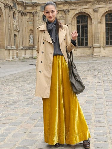 Transport your style back in time to the Victorian era with a flowing velvet skirt and a tan trench.