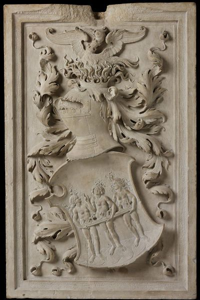 This coat-of-arms comes from the Palazzo Alidosio at Cesesna in Italy (demolished between 1838 and 1846).  The three naked women depicted on the shield are the Three Graces, the emblem of Obizzo. Heraldry from this period did not shrink from representing naked human figures, but often found ingenious ways of preserving their decency. Here the coronet which maintains the dignity of the women also signifies Obizzo's status as Lord of Castelo del Rio.