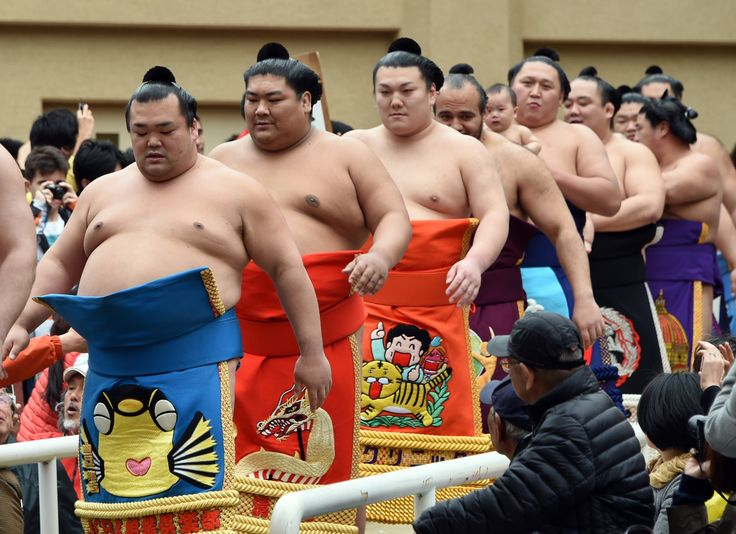 Tokyo, Japan Sumo wrestlers in the Honozumo, a ceremonial sumo exhibition at the Yasukuni shrine