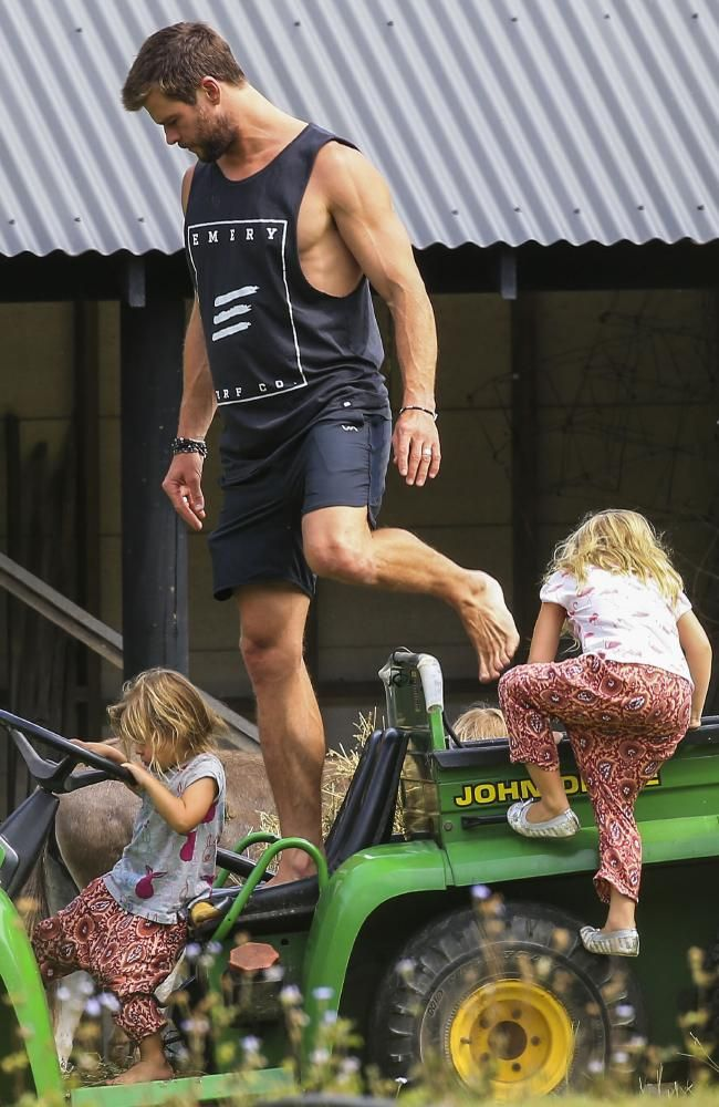 Chris Hemsworth riding a tractor with his kids on his farm | photos | The Courier-Mail