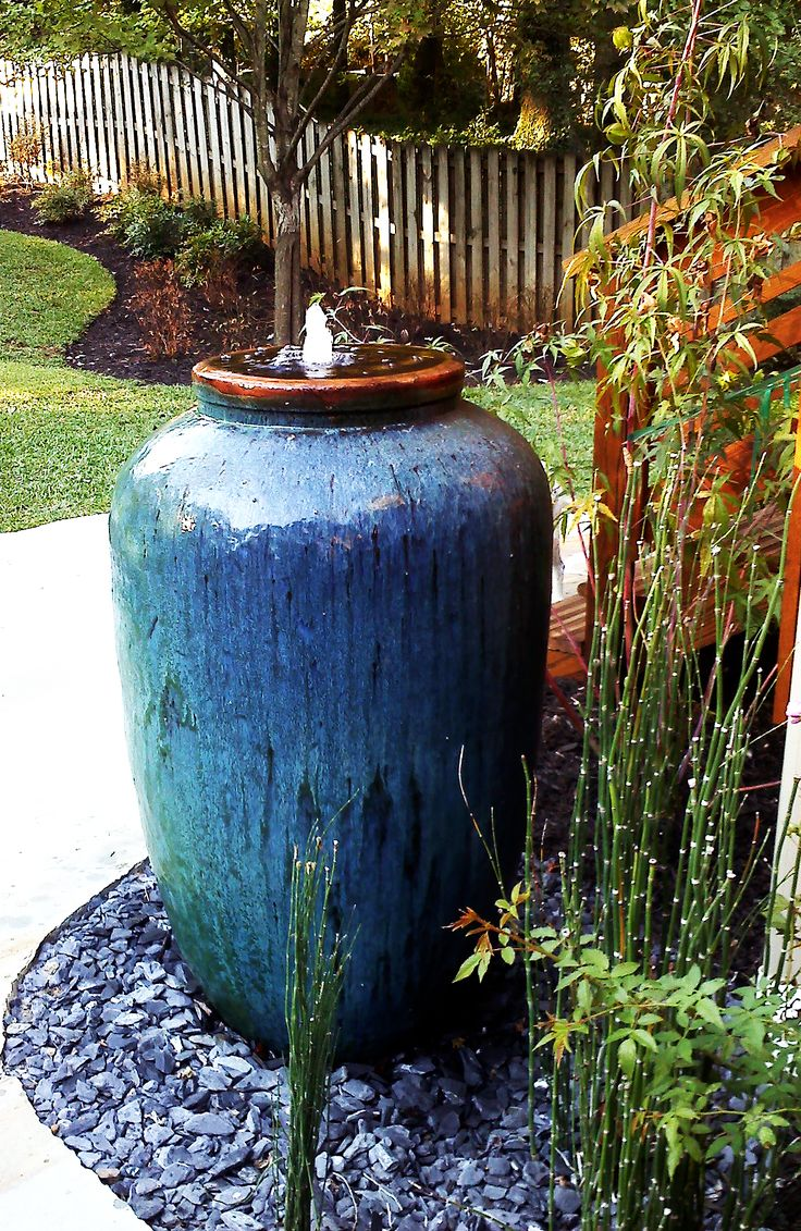 Olive shape jar makes great fountain for your backyard for Garden feature ideas