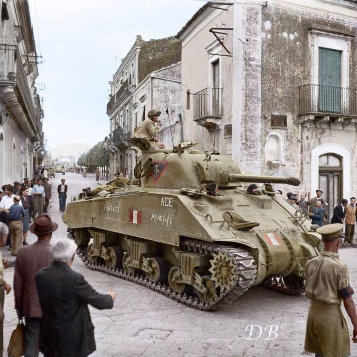 M4A4 Mk.V Sherman tank (T-147477) of 'A' squadron 4 troop, Ontario Regiment, 1st Canadian Armoured Brigade, passes through Via Don Luigi Sturzo, Trecastagni, Sicily 9 August 1943.