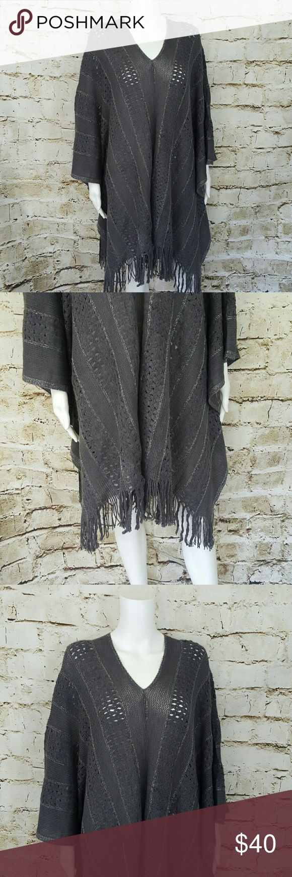 BCBGMAXAZRIA sweater poncho This is a one size fits all sweater.  It has armpit holes so it's a sweater that looks like a poncho perfect with skinny jeans or leggings and boots!  Super comfy, great for festival look with silver metallic thread woven throughout BCBGMAXAZRIA  Sweaters