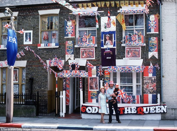Picture of patriotism: A family in Fulham, West London, decorated their home in preparatio...
