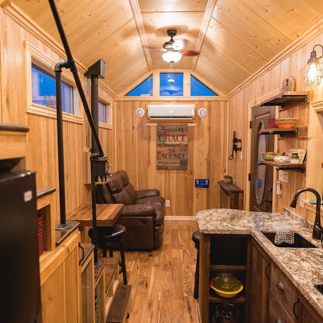 A Stunning Luxury Tiny Home From California Tiny House. Its Interior  Features Two Fireplaces, A Full Kitchen, Bathroom, And A Cozy Loft Bedroom.