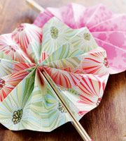 Cute paper fans attached to jumbo sticks so they unfold into a beautiful flower like fan!