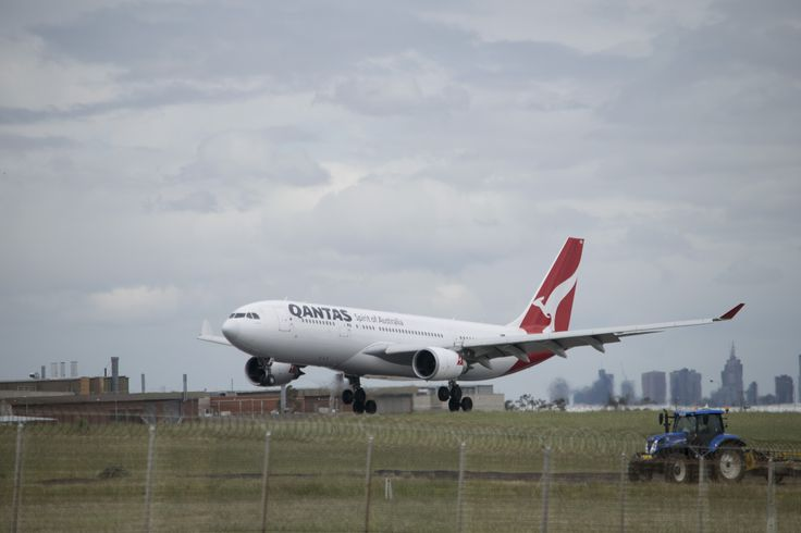 Qantas A330 coming in to land while the grass was being beaten back into submission