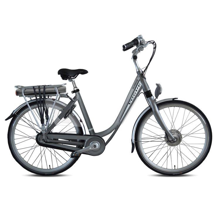 Vogue Elektrische fiets Glamour dames zilver 50cm 374 Watt Zilver  Description: De Vogue Glamour E-bike is een luxe elektrische fiets die van alle gemakken is voorzien. De accu is slank betrouwbaar en krachtig want met zijn 36 volt en 104 ampère fiets je in de eco-stand 80 tot 100 kilometer. Halfords Bike Lease geeft je de mogelijkheid een elektrische fiets te leasen in plaats van te kopen! Hierdoor heb je de zekerheid dat je nooit voor vervelende verrassingen of dure reparaties komt te…
