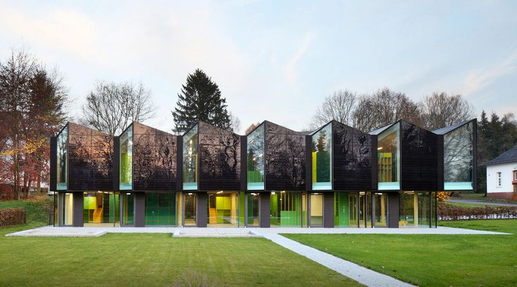 Saw-tooth roofed nursery blends in with the landscape in a historic campus in Germany | Inhabitat - Sustainable Design Innovation, Eco Architecture, Green Building