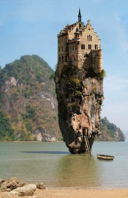Castle on a rock in Dublin, Ireland.    Sadly this is not real. This is a photo manipulation of an island in Thailand, which has no castle, by artist Jan Oliehoek.