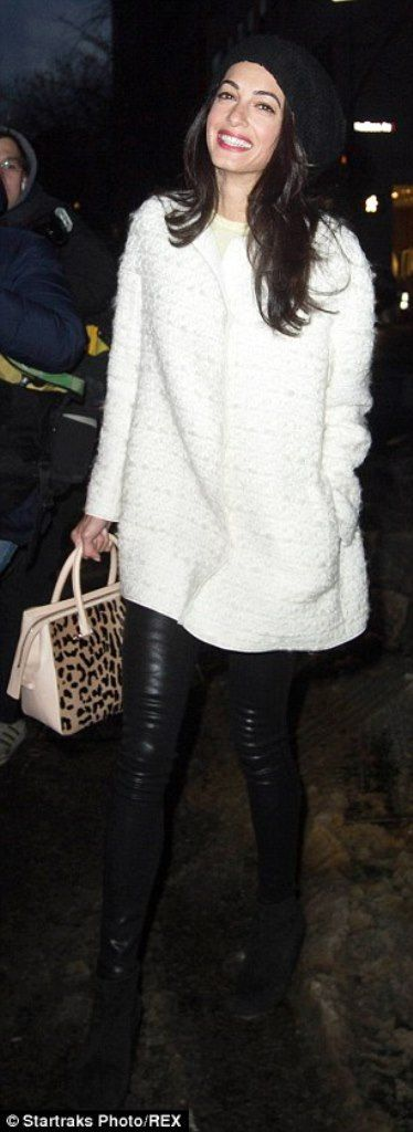 Amal Clooney was spotted leaving the Carlyle Hotel on March 6, 2015. She was wearing a blouclé short ivory coat, leather trousers and a leo printed bag – all by Gianbattista Valli. Hat by D&G. Suede boots by DKNY.
