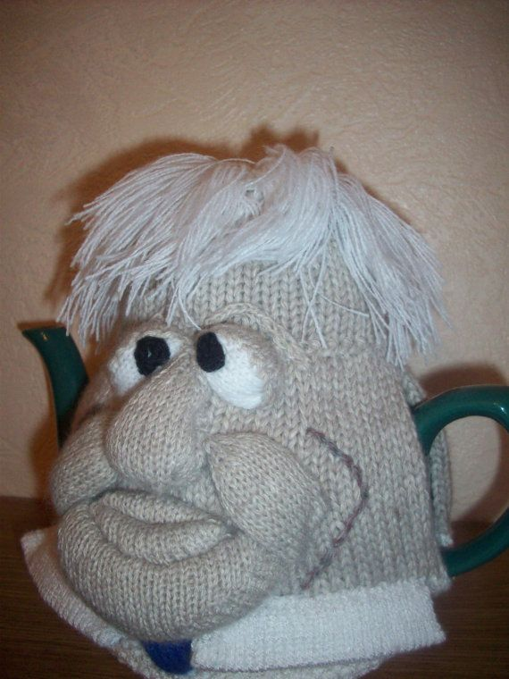 A RosieCosie by Linda Rose  This is my interpretation of a Boris Johnson style Ugly Mug tea cosy . The main part of the tea cosy is knitted in a chunky yarn with his head lightly stuffed (BS5852) to create a cute and cuddly appearance as well as keeping the tea warm in the pot. Please note the gorgeous blonde mop of hair, each strand individually attached. The features are finished in a finer 4ply yarn to enable greater detail. Now you can have breakfast with Boris!! My tea cosies are…