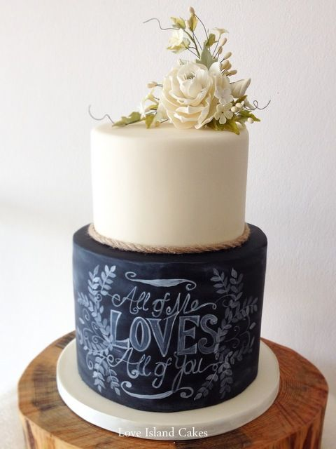 This Chalkboard & Gardenia wedding cake adds a beautiful touch to any rustic wedding.