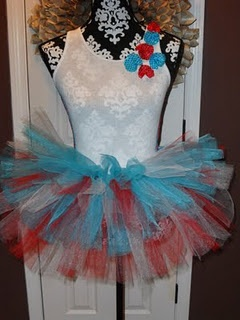Supplies needed:  3 rolls of tulle (any colors but mine are red, white, and blue)  Scissors  Tape Measure  Elastic Headband