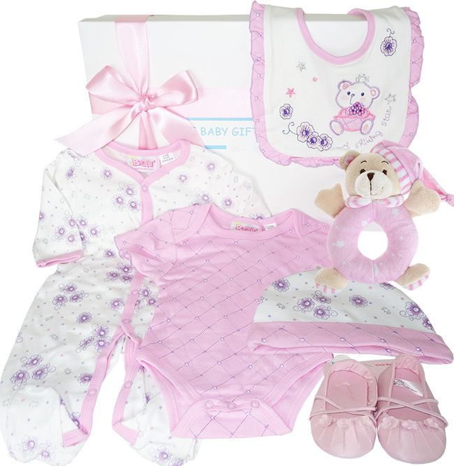 Shining Star Baby Girl Gift hamper filled with pretty cotton baby wear, gorgeous pink baby shoes and an adorable teddy bear rattle