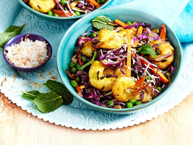 This curried coconut and prawn stir-fry is packed with veges and spices to create a vibrant meal that's a healthy and flavourful weeknight dinner