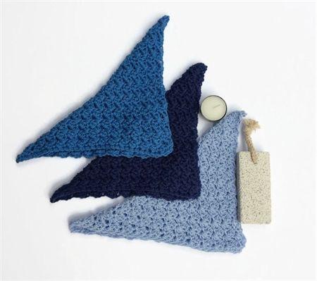 Three blue washcloths in crocheted Australian cotton
