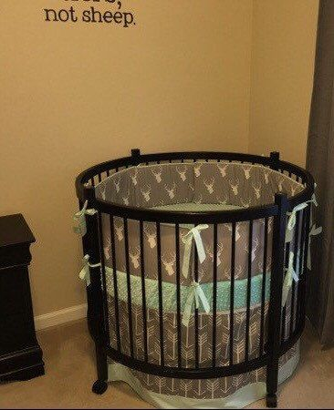 A personal favorite from my Etsy shop https://www.etsy.com/listing/230287347/deposit-round-crib-bedding-in-aqua-mint  Gray and aqua stag round crib bedding