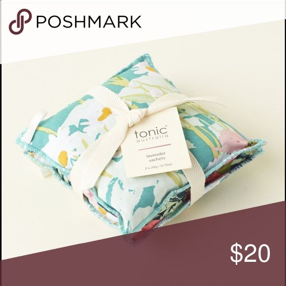 Tonic Australia Lavender Sachets Set of 2 • Great for placing in drawers with your clothes and towels • Wards off bugs • Use ribbon loop to hang with your winter coats  Dimensions: 11 x 11 x 3 cm Keep your home smelling fresh and lovely year round with tonic's eco sachets. These multi-purpose sachets are made from 100% cotton & filled with locally sourced lavender. Place them with your clothes & towels, hang them with your winter coats and place them in the pantry for that clean fresh…