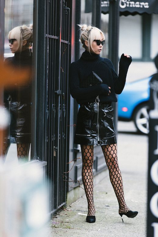 Le Fashion Blog Black Chunky Turtleneck Sweater Black Leather Skirt Fishnet Tights Black Kitten Heel Shoes Via The Haute Pursuit