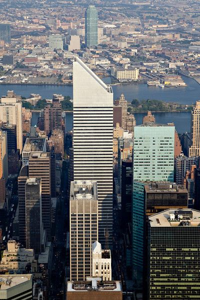 Description of  Citigroup Center, center, stands in between Citigroup corporate headquarters, center front, and a Citi building in the Queens borough of New York, top, in this aerial photograph taken over New York, U.S., on Wednesday, July 7, 2010.  Photographer: Daniel Acker/Bloomberg