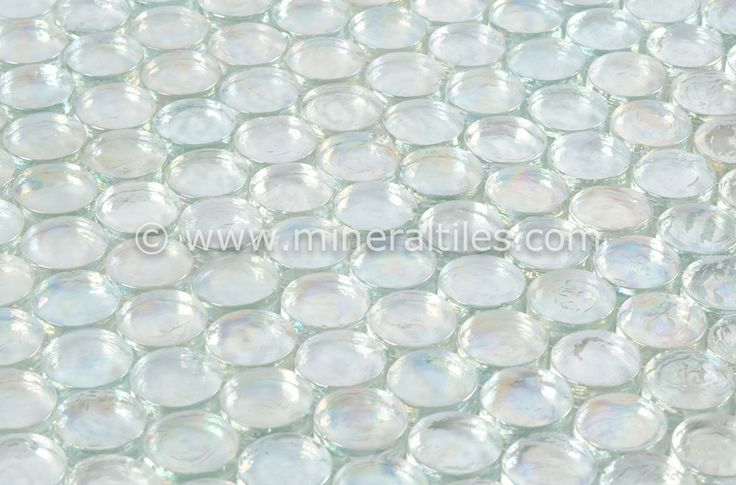 Mineral Tiles - Iridescent Pool Glass Tile Clear Penny Round, $14.95 (http://www.mineraltiles.com/iridescent-pool-glass-tile-clear-penny-round/)
