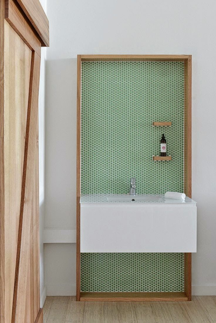 wooden frame and green tiles + floating sink