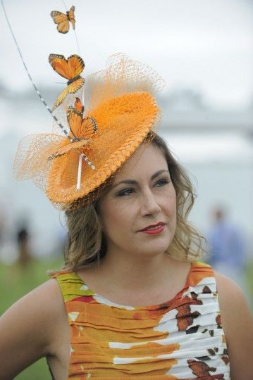 "Pilar Williams, 40, Crofton, non profit. ""Bright. In style. Fashionable."" (Lloyd Fox/The Baltimore Sun) #preakness #butterflies #orange #hats"