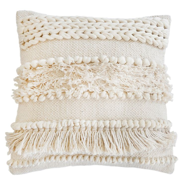 """The Iman pillow from Pom Pom at Home offers earthy elegance to eclectic sofas and chairs. Tiered rows of tassels, braids, and pom poms adorn this handwoven cushion, exuding tantalizing texture in a versatile ivory palette. The striking design perfectly complements any style, from boldly modern to boho chic. 20""""W X 20""""H. 100% cotton. Handmade. Insert Included."""