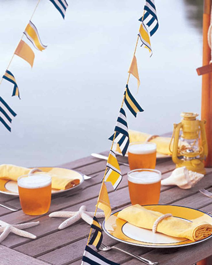 Salute guests at your next outdoor party with garlands made from ribbon in nautical-themed stripes and solids.