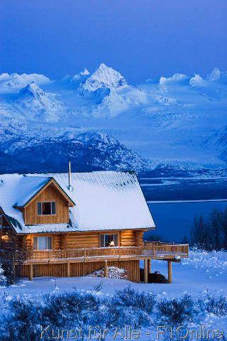 Sunset on a Log home that overlooks Kachemak Bay above Homer on the Kenai Peninsula in Southcentral, Alaska, USA