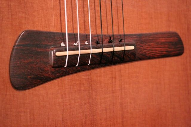 Modern nylon string guitar bridge