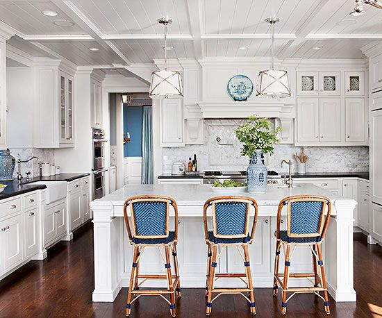 Cool chrome accents, warm wood floors, and Chinese pottery blues come together this enviable kitchen: http://www.bhg.com/kitchen/color-schemes/neutrals/white-kitchen-design-ideas/?socsrc=bhgpin032715blueandbreezy&page=3