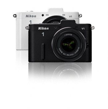 Saw this Hipster-looking Nikon 1 in Virgin Megastore the other day. It is gorgeous and even has groovy strap-holders on each side so it hangs round your neck like camera-bling!