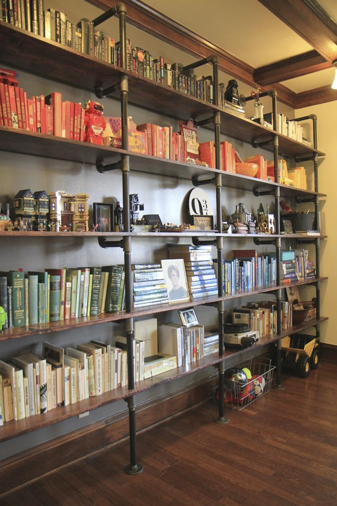 Pipe shelving. Or maybe at the bottom of the stairs. Set out our books and use baskets for crafts.