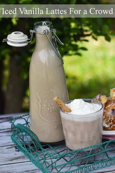 Iced Vanilla Lattes For a Crowd. Perfect for a brunch! So easy to make and so much more affordable than buying the pre made bottles!