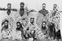 Gungunhana, with the seven wives taken with him as prisoners to Lisbon (photo taken in March, 1896)