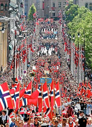 Syttende Mai in Oslo, Norway  (I have been to Karl Johan's Gate and the Royal Palace ... but not on May 17th)