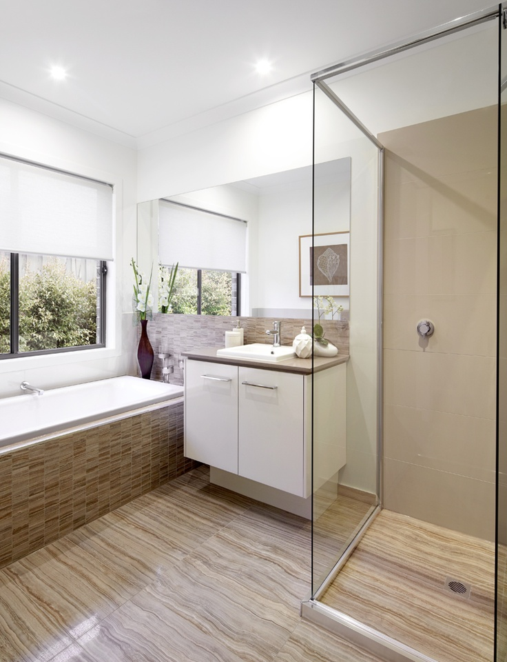 Woodgrain tiling is extended from the main bathroom floor through to the tiled shower base. As seen on the St Tropez 28.