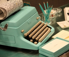 aqua typewriter.  If I were braver and willing to take apart my ugly but functional machine, I'd totally paint it an awesome color or two, like so.