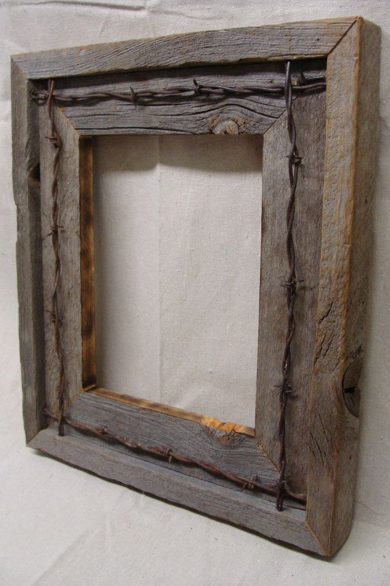 This rustic frame has Barbed Wire wrapped around the inside of the lip.. It has glass, turn buttons and hanging hardware. This is a custom made item please allow 1- 2 weeks for shipping.
