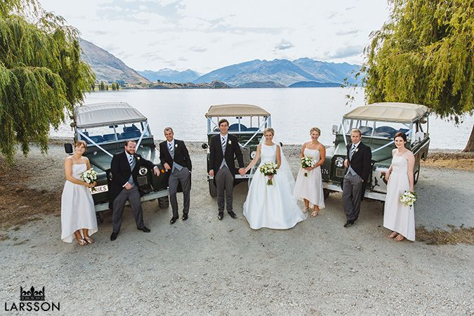 Bridal party on Wanaka Lakefront, Landcover wedding cars. Florals: http//:www.wanakaweddingflowers.co.nz/