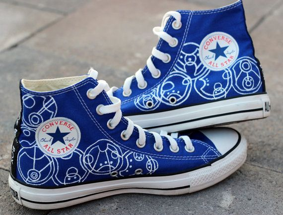 "SIDE 2 OF THE AMAZING SHOES- written in Gallifreyan the left side says ""Nice to meet you Rose Tyler"" and the right says ""now run for your life"""