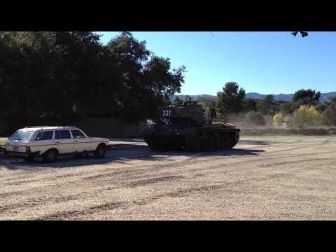 Arnold Schwarzenegger Crushes A Car With His Tank