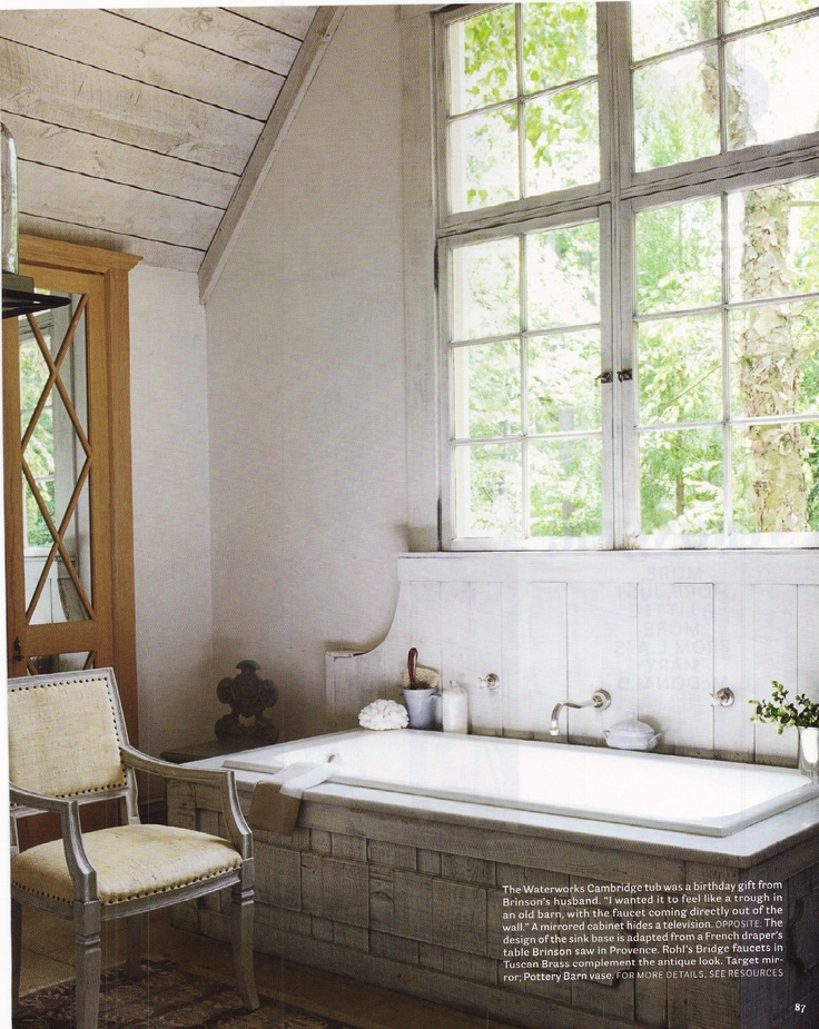 Shabby Chic bathroom with lots of natural light and cool bathtub