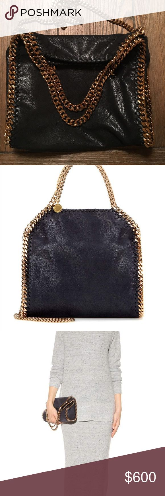Stella McCartney mini Falabella bag Falabella mini faux brushed-leather shoulder bag.  Falabella shaggy deer small tote in black featuring a gold diamond cut chain trim and handles with a Stella McCartney logo disc.  Spot clean with a soft damp cloth and a small amount of neutral soap. Avoid scrubbing in order not to damage the textured surface of the bag.  This bag is made from non-leather, cruelty-free materials using highly skilled manufacturing techniques. The lining has been created…