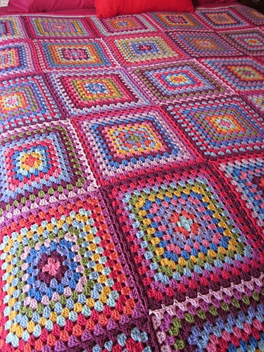 #crochet a granny square afghan...I love all the colors...a good stash buster project...