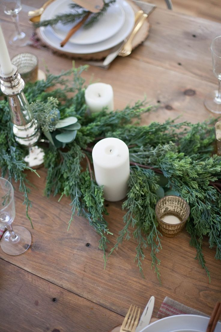 A beautiful farmhouse Christmas tablescape with rustic elements, mixed metals, and natural greenery. Perfect for a hosting a holiday dinner!   @worldmarket and #ad   Christmas Tablescapes   Holiday Tablescapes   Decorating for Christmas   Dining Room Holiday Decor   Holiday Home Decor Ideas   Tips for Decorating for the Holidays    Lauren McBride
